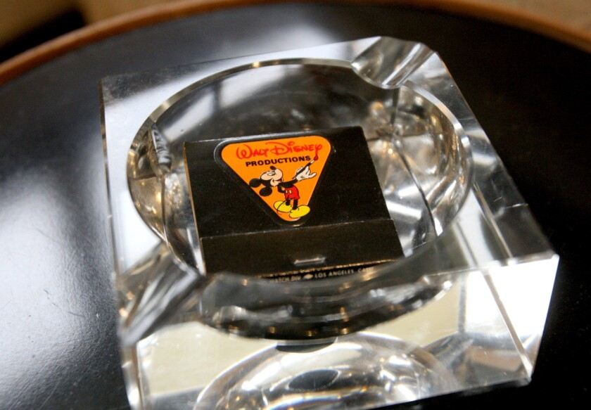 Ashtrays and matches displayed throughout Walt Disney's restored Burbank office suite