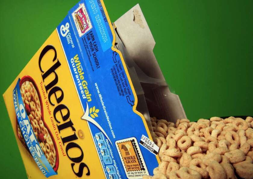 General Mills said it will stop sourcing genetically modified corn and sugar cane for its signature breakfast cereal.