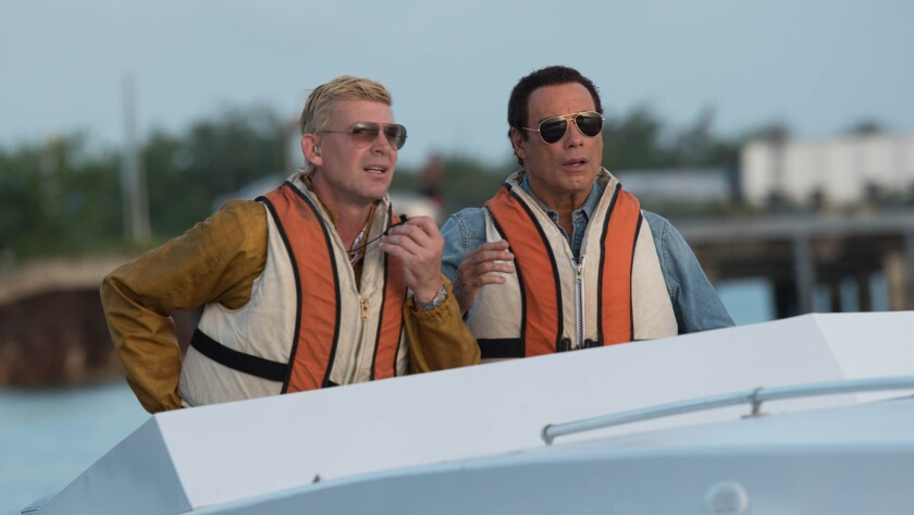 (L-R) Craig Chamberlin as Nick Brady and John Travolta as Ben Aronoff in the action film ?SPEED KILL