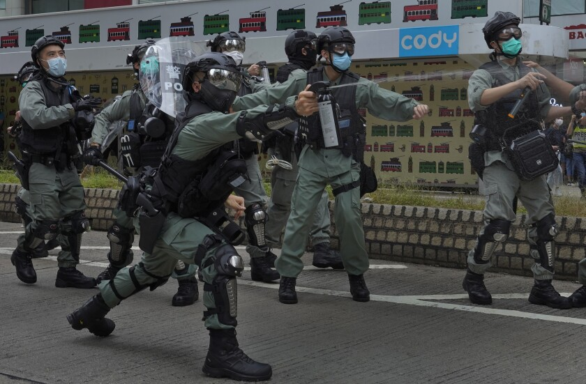 Riot police and protesters clash in a demonstration against Beijing's national security legislation May 24 in Hong Kong.
