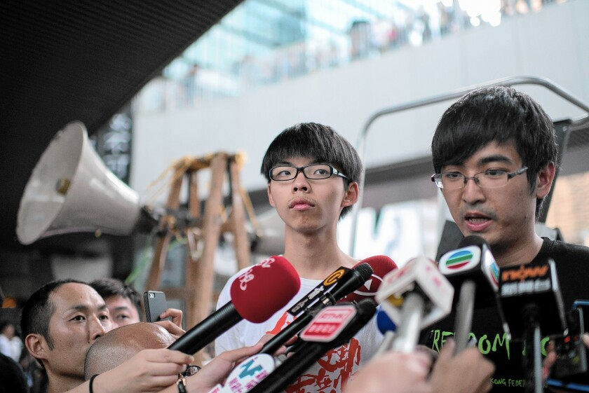 Alex Chow, head of the Hong Kong Federation of Students, speaks to reporters on Oct. 4. Next to him is Joshua Wong, 17, leader of a high school activist group.