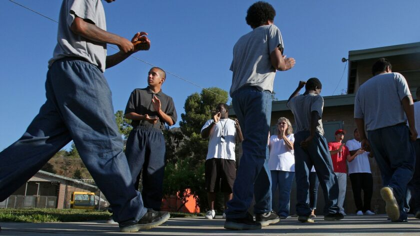 David, 16, from second left, greets other juvenile students at Camp Afflerblaugh in La Verne on Wedn