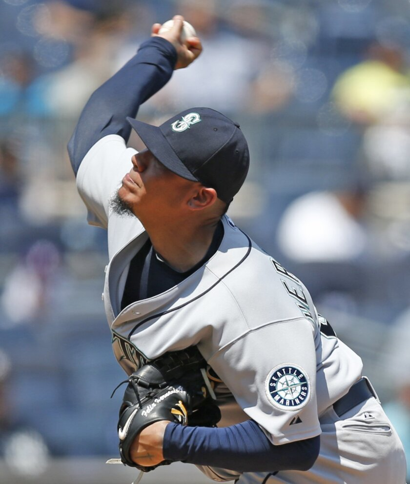 Seattle Mariners starting pitcher Felix Hernandez delivers in the third inning of a baseball game against the New York Yankees at Yankee Stadium in New York, Sunday, July 19, 2015. (AP Photo/Kathy Willens)