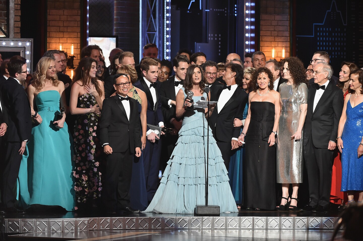 "Producer Stacey Mindich, at the mike, and the cast of ""Dear Evan Hansen"" accept the award for best musical at the conclusion of the 2017 Tony Awards at Radio City Music Hall in New York City."