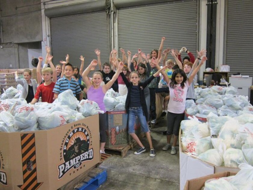 The Gillispie School fourth-grade class helps pack vegetables at the San Diego Food Bank.