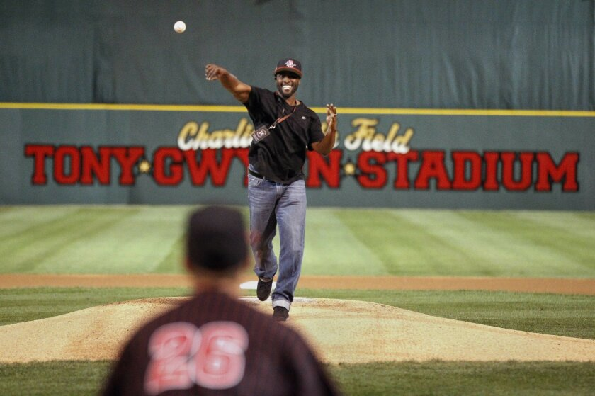 Tony Gwynn Jr. throws out the ceremonial first pitch to Aztecs player Hunter Stratton during a ceremony retiring Tony Gwynn's jersey number No. 19 prior to the Aztecs opening baseball game against Valparaiso at Tony Gwynn Stadium in San Diego on Friday.