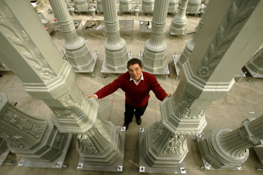 """Chris Burden stands amid """"Urban Light,"""" his installation at the Los Angeles County Museum of Art."""