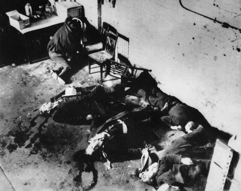 EDS NOTE: GRAPHIC CONTENT - FILE - This Feb. 14, 1929 photo shows the bodies of six of the seven men who were slain in the gangland Valentine's Day massacre on Chicago's North Side. James Sledge, an executive officer at the Cook County medical examiner's office and a local history fan, has unearthe