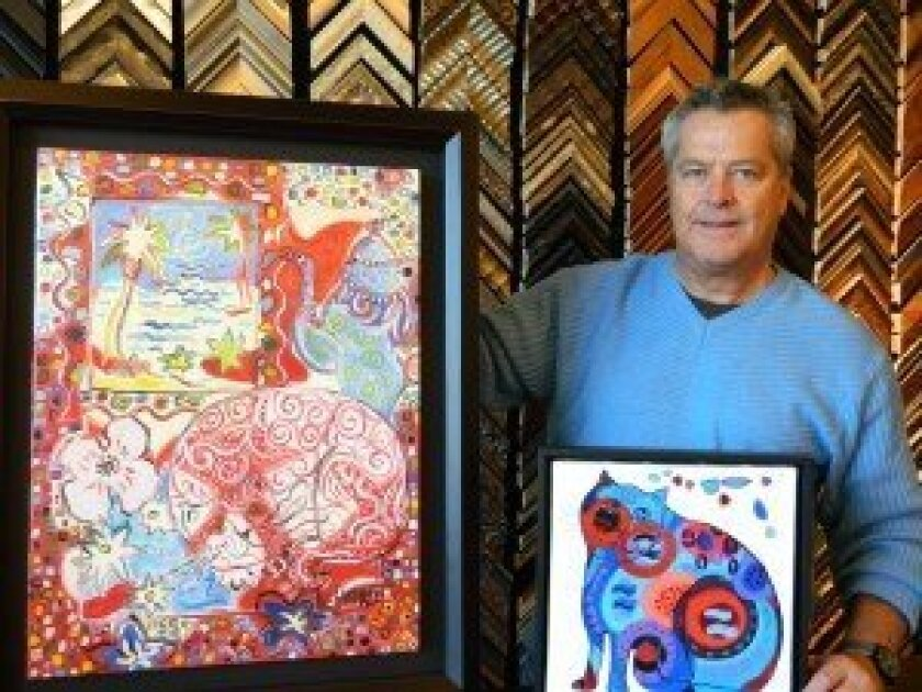Randy Gray, general manager of Art & Framing by Munro Gallery, with paintings by French artist Céline Chourlet. Photo/Kristina Houck