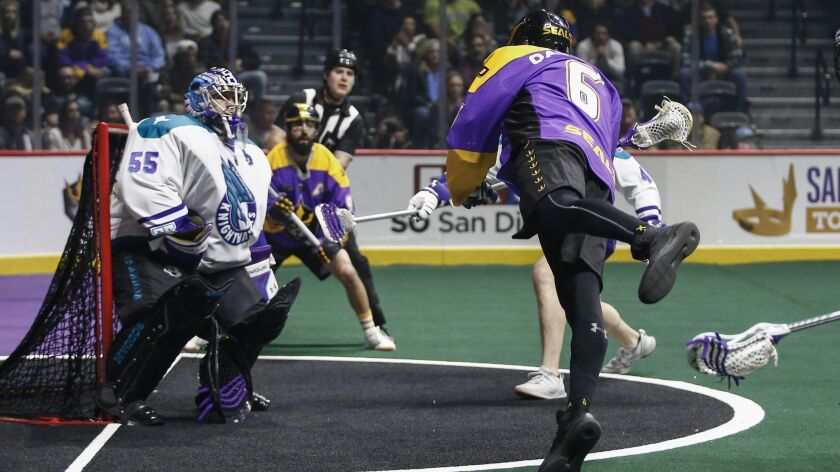 San Diego Seals forward Dan Dawson (6) takes a leaping shot on goal, which was saved by Rochester Knighthawks goalie Angus Goodleaf (55) in the first quarter.