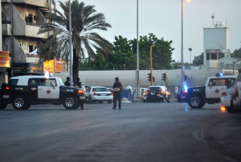 Saudi police stand guard at the site where a suicide bomber blew himself up early Monday near the American Consulate in the Red Sea city of Jidda.