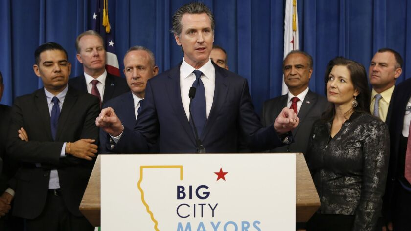 Gov. Gavin Newsom speaks at a news conference Wednesday after meeting with mayors from large California cities on homelessness funding.