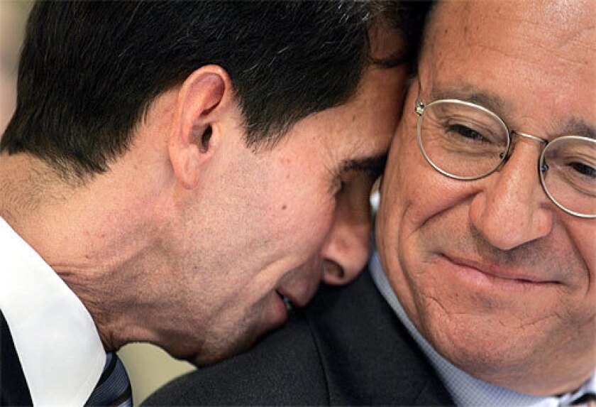 EMOTION: Assemblyman Mark Leno (D-San Francisco), author of the legislation, rests his head on the shoulder of Assemblyman Pedro Nava (D-Santa Barbara) seconds after the measure passed. Leno and gay and civil rights activists heavily lobbied wavering Democrats.