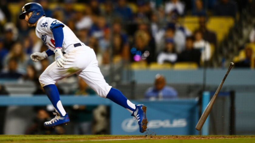 LOS ANGELES, CALIF. - APRIL 02: Los Angeles Dodgers center fielder Kiké Hernandez (14) runs to first