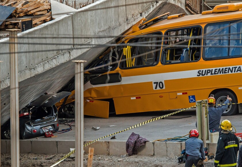 An unfinished overpass collapsed on vehicles in Brazil's southeastern World Cup city of Belo Horizonte on Thursday, officials said.