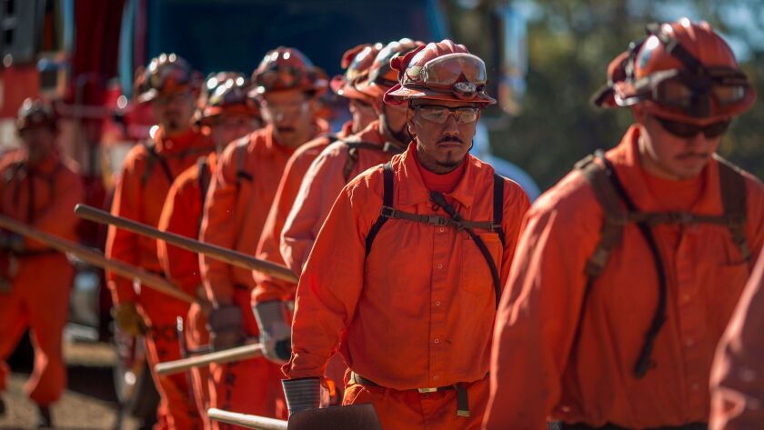Prisoners at Oak Glen Conservation Camp line up for work deployment under the authority of Cal Fire near Yucaipa in 2017.