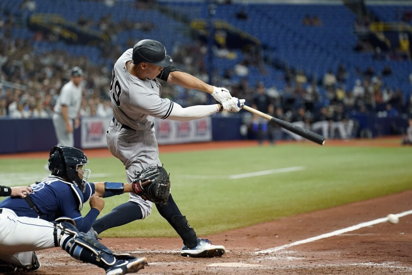 New York Yankees' Aaron Judge connects for an RBI single off Tampa Bay Rays relief pitcher Pete Fairbanks during the 10th inning of a baseball game Wednesday, July 28, 2021, in St. Petersburg, Fla. (AP Photo/Chris O'Meara)