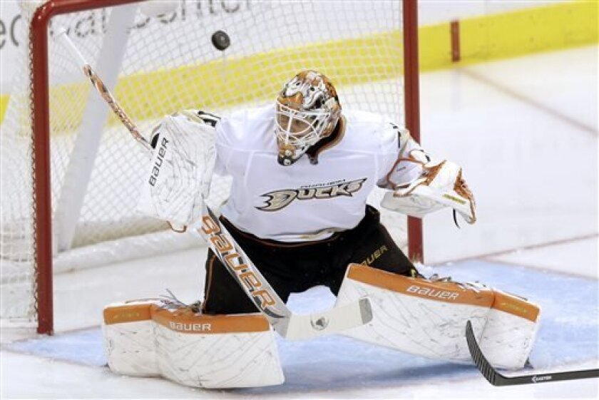 Anaheim Ducks goalie Viktor Fasth, of Sweden, makes a save against the Dallas Stars during the first period of an NHL hockey game in Dallas on Monday April 1, 2013. (AP Photo/Mike Fuentes)
