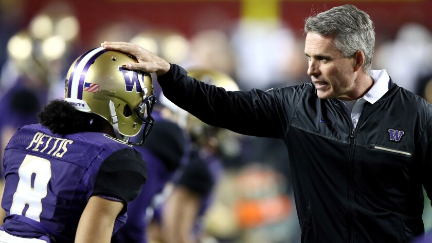 Chris Petersen lead Washington to a Rose Bowl berth last season and fell to Ohio State.