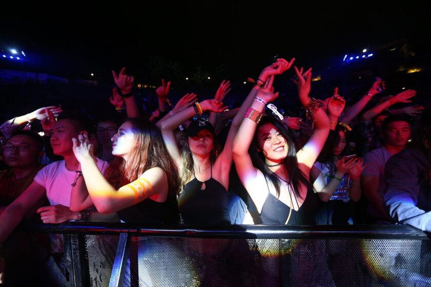 Fans attend the Great Wall Music Festival in Beijing on May 14.