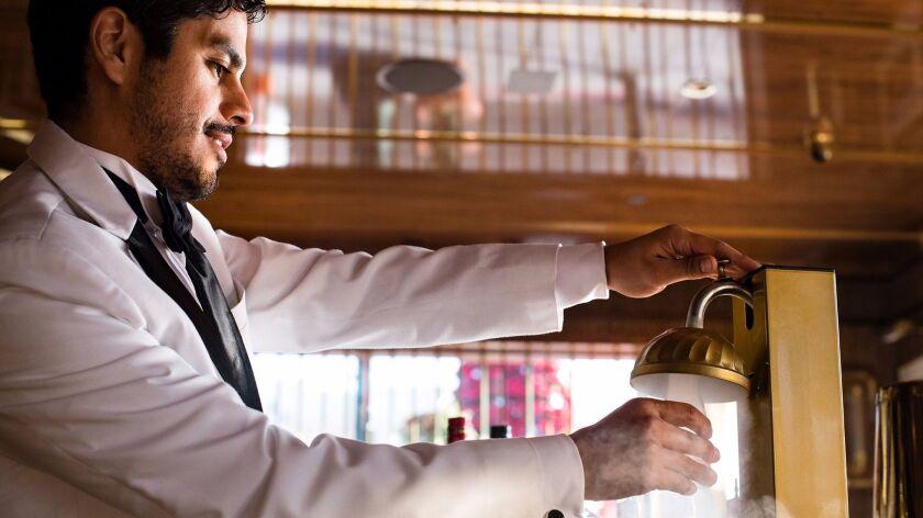 Born and Raised bartender Jordan Villa prepared cocktails tableside. Martinis, Manhattans and Rob Ro