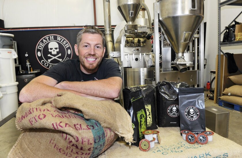 In this Monday, Sept. 21, 2015, photo, provided by QuickBooks, Michael Brown, owner of Death Wish Coffee Company, poses for a picture during Intuit QuickBooks Small Business Big Game finalists tour, in Round Lake, N.Y. Death Wish Coffee Co. won a competition held by software maker Intuit for a 30-second spot during the third quarter of the Super Bowl on Feb. 7, 2016. The Round Lake, N.Y., company beat more than 15,000 companies in voting by the public and Intuit employees.
