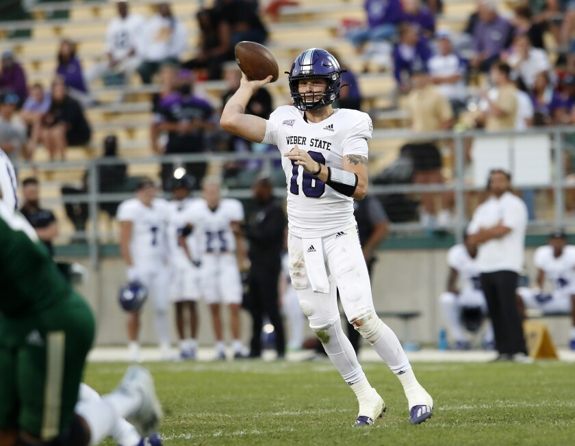 Weber State quarterback Kylan Weisser attempts a short pass during the first half of an NCAA college football game against Cal Poly, Saturday, Oct. 2, 2021 in San Luis Obispo, Calif. (Laura Dickinson/The Tribune (of San Luis Obispo) via AP)