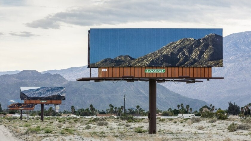 On Gene Autry Trail leading into Palm Springs, Jennifer Bolande posted billboards that picture the mountain view behind them.