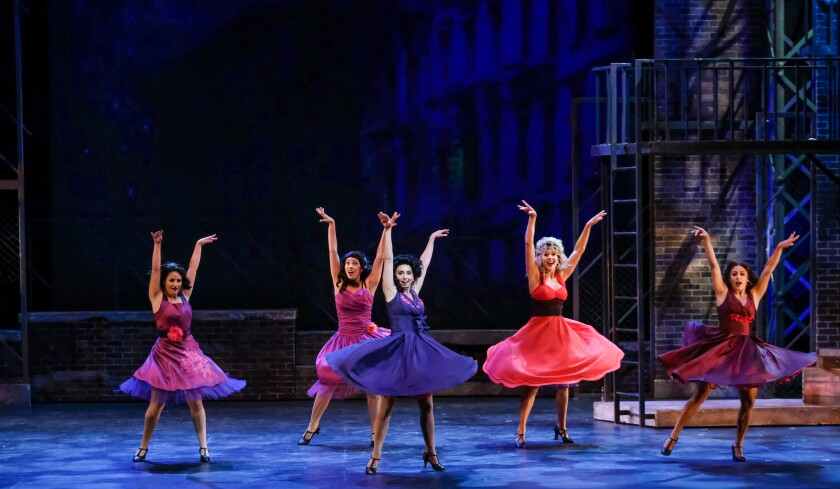 "Cast members perform the number ""America"" in Moonlight Stage Productions' ""West Side Story."""
