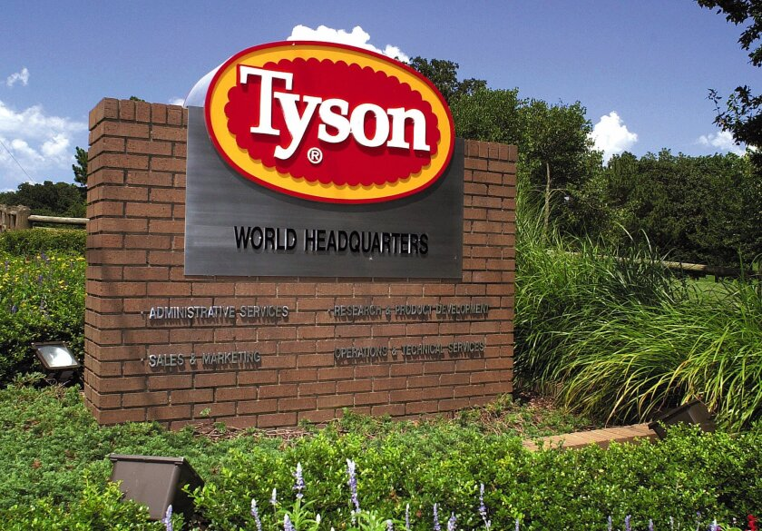 A Tyson Foods sign marks the entrance to the company's headquarters in Springdale, Ark., on July 30, 2001.