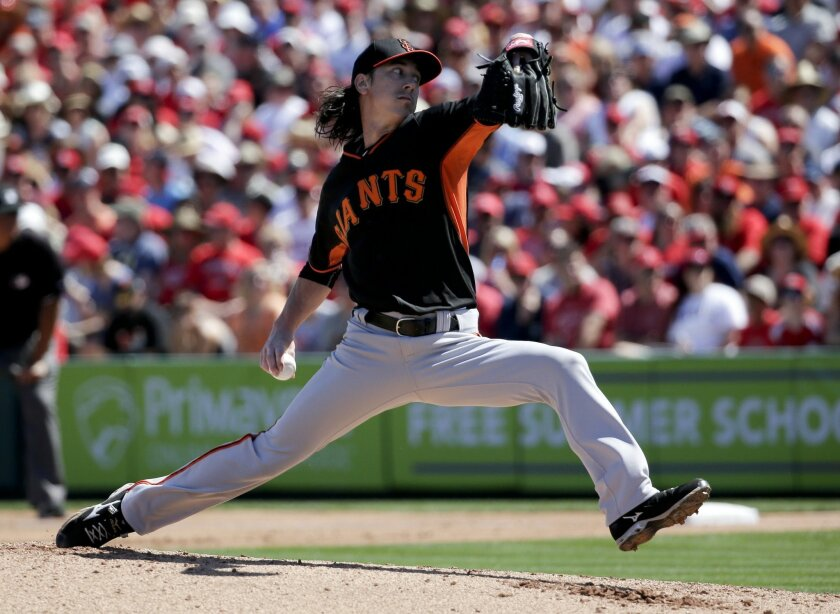 San Francisco Giants starting pitcher Tim Lincecum throws to the Los Angeles Angels during the first inning of a spring training baseball exhibition game in Tempe, Ariz., on Saturday, March 21, 2015. (AP Photo/Chris Carlson)