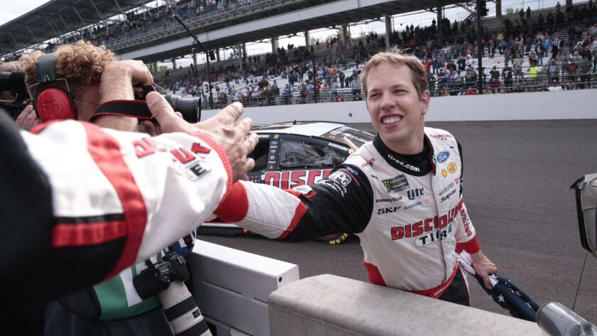 Brad Keselowski celebrates after winning the NASCAR Brickyard 400 auto race at Indianapolis Motor Sp