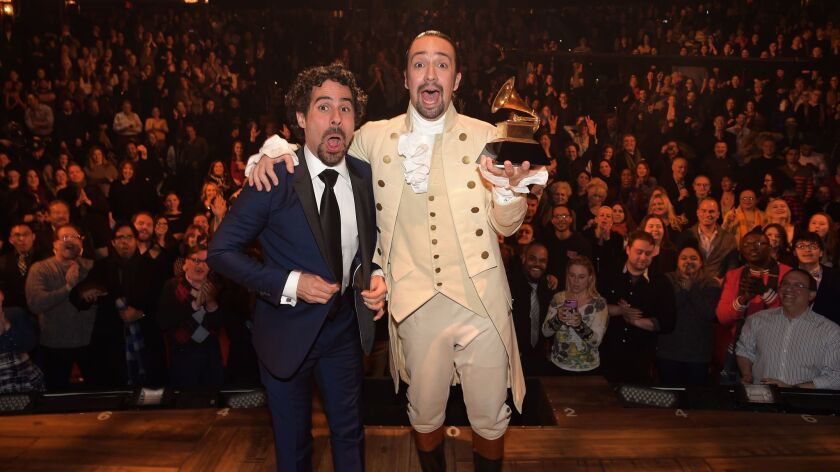 Lacamoire and Lin-Manuel Miranda celebrate on stage at the Richard Rodgers Theatre after performing