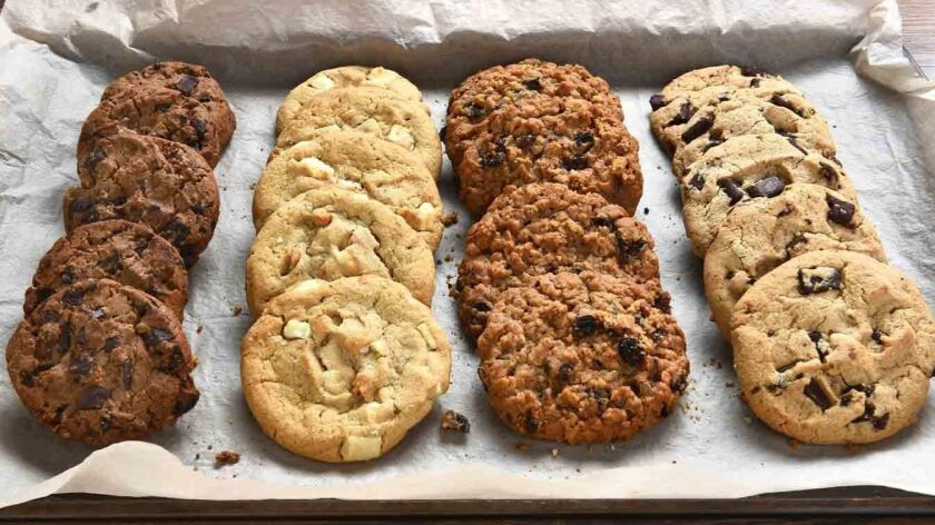 Closeup of a tray of fresh baked cookies, Chocolate Chip, oatmeal raisin Chocolate and white chocola