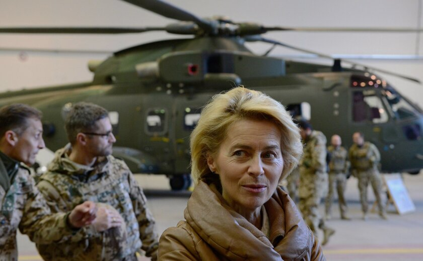 FILE -  In this Dec. 13, 2014 file picture German Defense Minister Ursula von der Leyen, center, greets German helicopter pilots in a hangar at Camp Marmal in Mazar-i-Sharif, Afghanistan. Germany is affirming its growing role on the world stage in new security guidelines that mark another step away