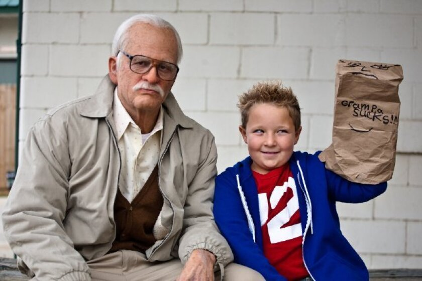 """Johnny Knoxville, left, and Jackson Nicoll star in """"Bad Grandpa,"""" which was No. 1 at the box office this weekend."""