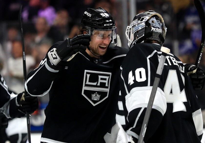 Kings defenseman Kurtis MacDermid celebrates with teammate Cal Petersen following a win over the Calgary Flames at Staples Center on Feb. 12.