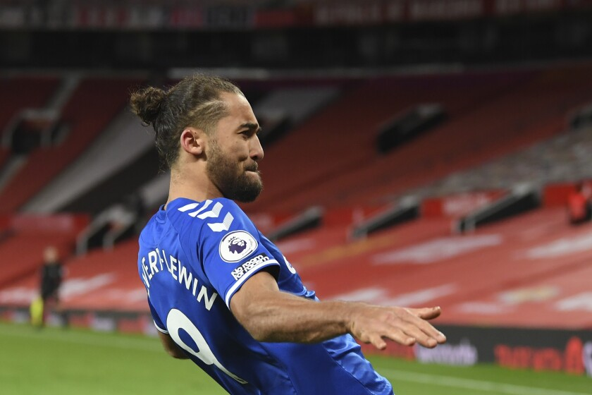 Everton's Dominic Calvert-Lewin celebrates after scoring his side's third goal during an English Premier League soccer match between Manchester United and Everton at the Old Trafford stadium in Manchester, England, Saturday Feb. 6, 2021. (Michael Regan/Pool via AP)