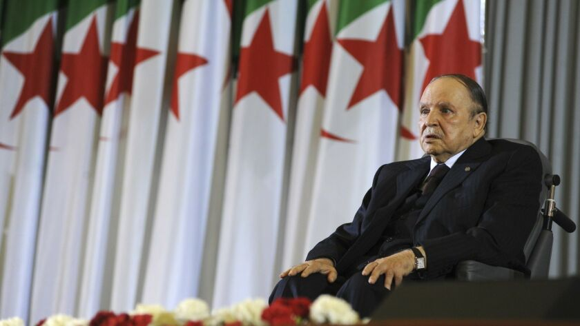 In this April 28, 2014, photo, Algerian President Abdelaziz Bouteflika sits in a wheelchair after taking the oath as president in Algiers, Algeria.