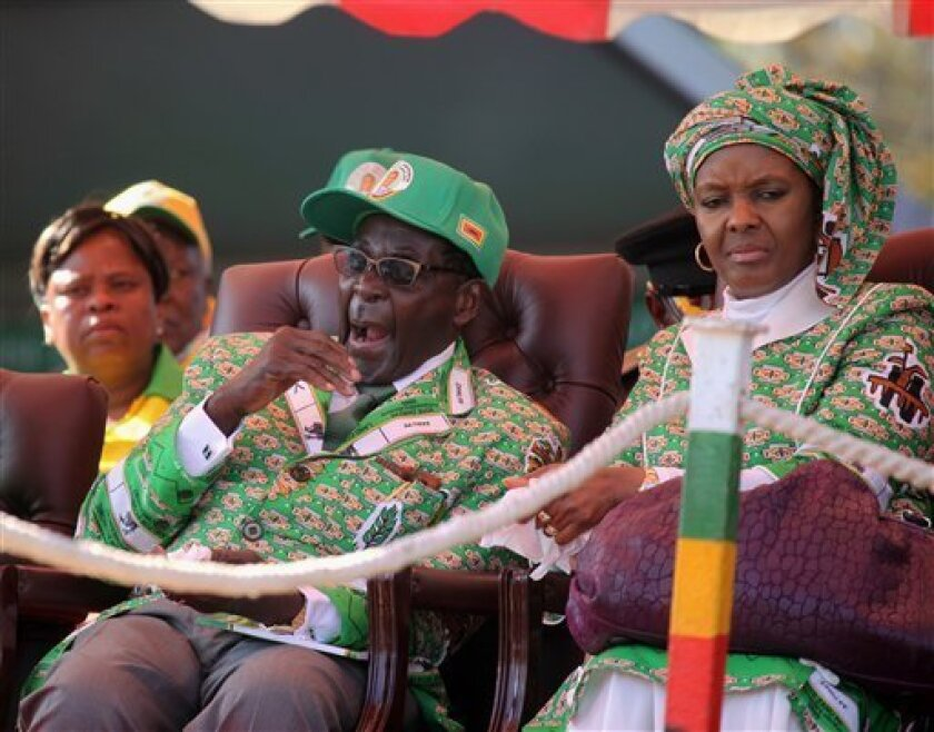 Zimbabwean President Robert Mugabe, left, and his wife Grace, at the launch of his party's election campaign in Harare, Friday, July, 5, 2013. Mugabe who is set to contest against his main rival Morgan Tsvangirai in a election set for July 31 urged his party supporters to vote for him in the crucial election. (AP Photo/Tsvangirayi Mukwazhi)
