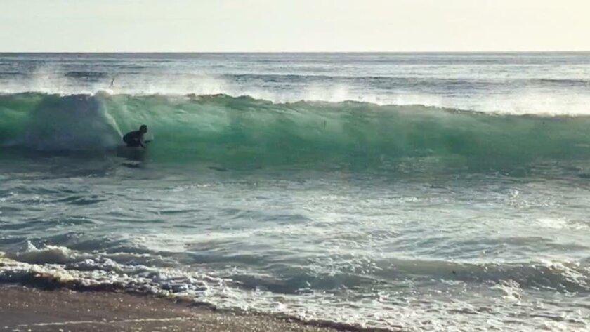 Surf Diva Instructor Canyon Grove riding a Moda board.