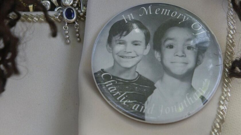 Milena Sellers wore a button with a photo of her son Jonathan and his friend Charlie Keever, who were killed by Scott Erskine.