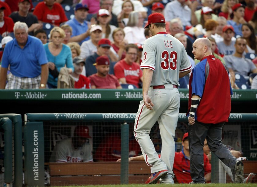 Philadelphia Phillies starting pitcher Cliff Lee (33) walks to the dugout during the third inning of a baseball game against the Washington Nationals at Nationals Park Thursday, July 31, 2014, in Washington. The Phillies announced that Lee had a recurrence of the left flexor pronator strain that si