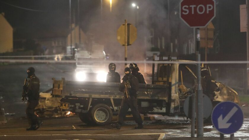 Police guard a crime scene during unrest in the Creggan area of Londonderry, in Northern Ireland, Th