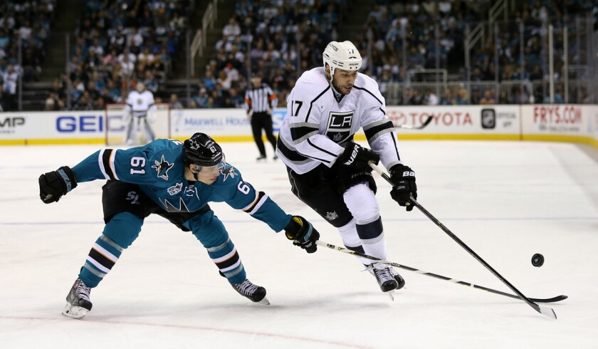 The Kings' Milan Lucic, right, and the Justin Braun go for the puck in Game 4 of the Western Conference first-round series on April 20.