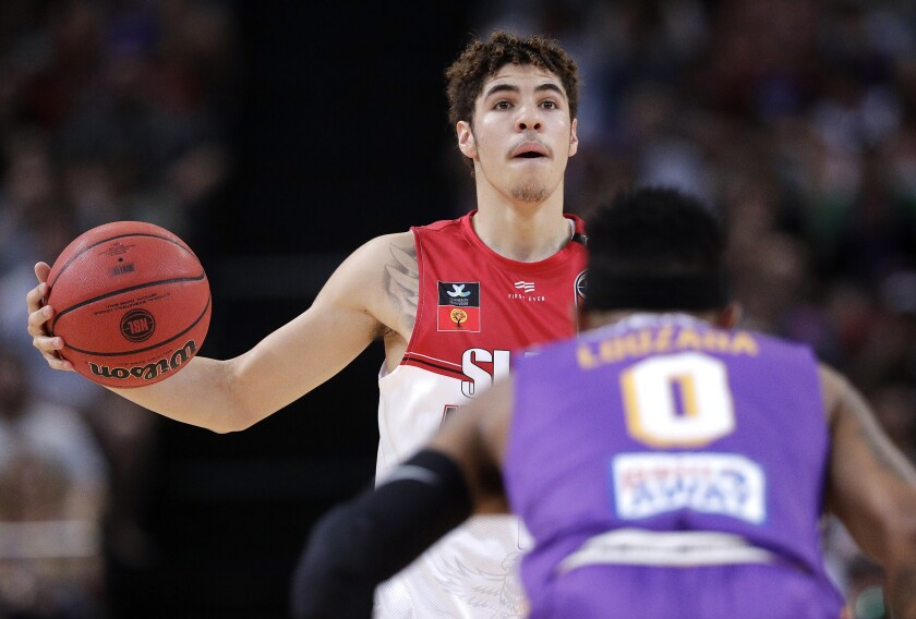 LaMelo Ball of the Illawarra Hawks controls the ball against the Sydney Kings.