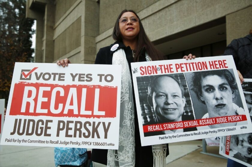 Ana Gabriela Hermosillo joins in a protest calling for the recall of Santa Clara County Judge Aaron Persky at the Santa Clara County Registrar of Voters office in San Jose, Calif., Thursday, Jan. 11, 2018.