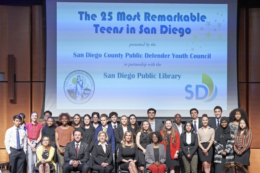 """The county Public Defender's Office and Public Defender Youth Council honored the county's 25 """"most remarkable teens"""" at a ceremony in May 2019. Presenting the awards were, seated from left to right, San Diego County Supervisor Nathan Fletcher, San Diego City Council President Pro Tem Barbara Bry, Supervisor Kristin Gaspar and Councilmember Monica Montgomery."""