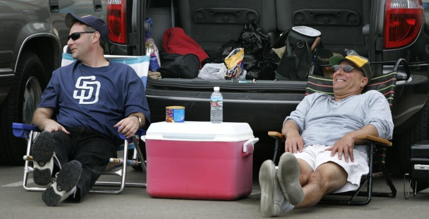 This 2005 photo of Padres fans John Twombly, 44, of Escondido and Gary Delena, 52, of Escondido, shows how Tailgate Park gets used on game day. One day it could be redeveloped into housing or perhaps a new sports arena.
