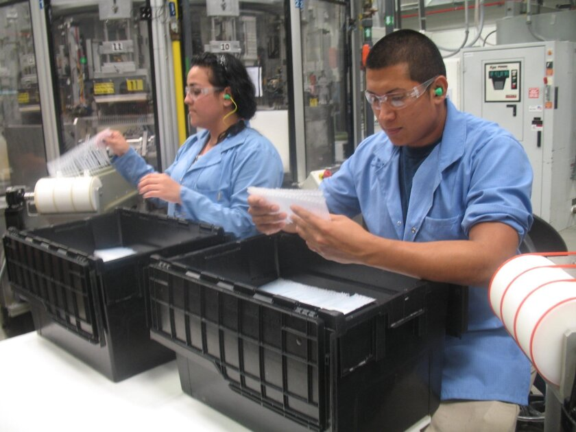Workers at Welch Allyn Mexico in Tijuana assemble medical devices.